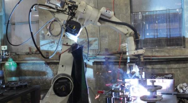 Robot hóa qui trình gia công nhông của Tiger